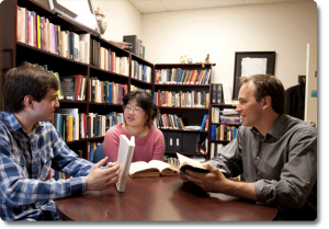 An Honors College advisor is advising two students at the Honors College